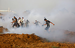 Palestinian protesters gather during clashes with Israeli security froces in a tent city protest where Palestinians demand the right to return to their homeland and against U.S. embassy move to Jerusalem at the Israel-Gaza border, at the Israel-Gaza border, in east of Gaza city, on May 25, 2018. Photo by Atia Darwish