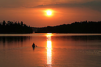 """""""Paddling into the Sunset""""<br /> <br /> A canoeist paddles into the quiet solitude of a wilderness sunset in Quetico Provincial Park."""