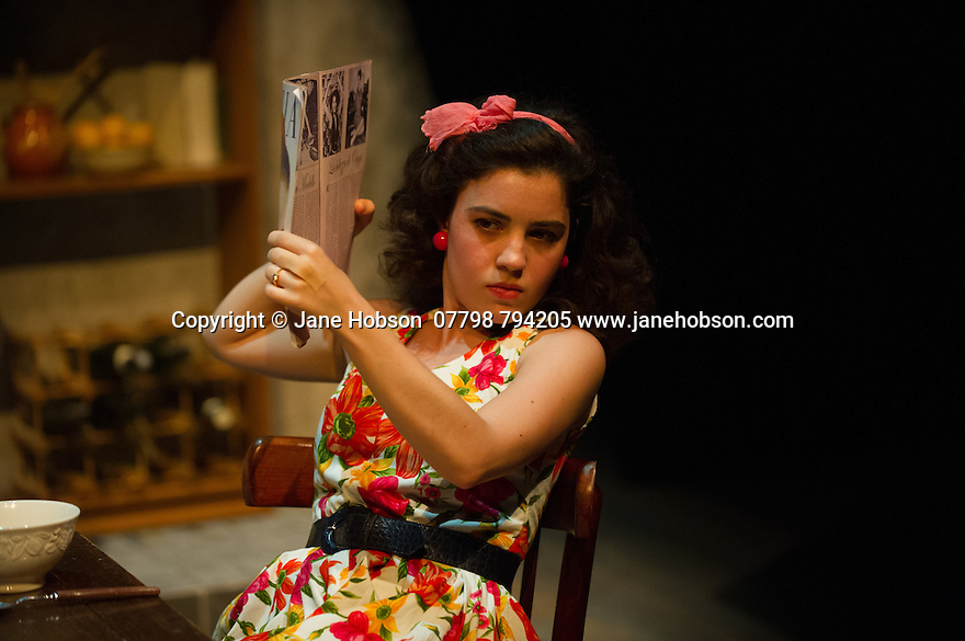London, UK. 18.07.2014. Mountview Academy of Theatre Arts presents SATURDAY, SUNDAY, MONDAY by Eduardo de Filippo, the English adaptation by Keith Waterhouse & Willis Hall, directed by Michael Howcroft, at the Unicorn Theatre, as part of the Postgraduate Season 2014. Picture shows:  Amy Tobias (Guillianella). Photograph © Jane Hobson.