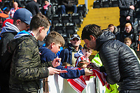 Lincoln City manager Danny Cowley signs an autograph for a fan during the pre-match warm-up<br /> <br /> Photographer Chris Vaughan/CameraSport<br /> <br /> The EFL Sky Bet League Two - Lincoln City v Cheltenham Town - Saturday 13th April 2019 - Sincil Bank - Lincoln<br /> <br /> World Copyright &copy; 2019 CameraSport. All rights reserved. 43 Linden Ave. Countesthorpe. Leicester. England. LE8 5PG - Tel: +44 (0) 116 277 4147 - admin@camerasport.com - www.camerasport.com