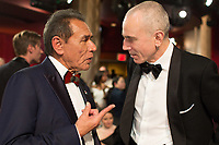 Wes Studi talks with Oscar&reg;-nominee Daniel Day-Lewis during the live ABC Telecast of the 90th Oscars&reg; at the Dolby&reg; Theatre in Hollywood, CA on Sunday, March 4, 2018.<br /> *Editorial Use Only*<br /> CAP/PLF/AMPAS<br /> Supplied by Capital Pictures