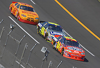 Apr 29, 2007; Talladega, AL, USA; Nascar Nextel Cup Series driver Jeff Gordon (24) leads teammate Jimmie Johnson (48) and Ryan Newman (12) during the Aarons 499 at Talladega Superspeedway. Mandatory Credit: Mark J. Rebilas