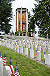 Memorial Day Ceremony at cemetary with American Flags at grave sites