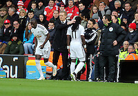 Pictured: Marvin Emnes of Swansea (11) is pat on the head by manager Garry Monk as he is being substituted by team mate Modou Barrow Sunday 01 February 2015<br />