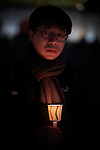 The Rev. Joshua Lian of the Presbyterian Church in Taiwan participates in a candlelight vigil for peace in the Korean Peninsula on December 9, 2017, in Gwanghwamun Square in Seoul, South Korea. The ecumenical Advent vigil was part of &quot;A Light of Peace&quot; campaign sponsored by the World Council of Churches and the National Council of Churches of Korea.<br /> <br /> Lian was in Seoul to participate in a WCC Consultation on Ecumenical Diakonia. <br /> <br /> The candlelight vigils were held in Seoul December 3-9, after which churches throughout the country planned to continue the vigils in small towns and villages.