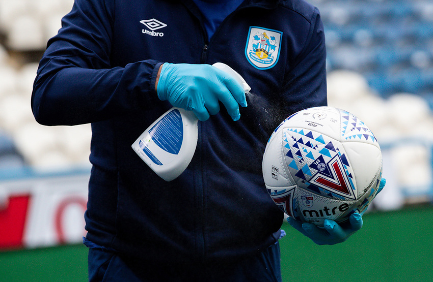 A member of the Huddersfield Town team cleans match balls<br /> <br /> Photographer Alex Dodd/CameraSport<br /> <br /> The EFL Sky Bet Championship - Huddersfield Town v Wigan Athletic - Saturday 20th June 2020 - John Smith's Stadium - Huddersfield <br /> <br /> World Copyright © 2020 CameraSport. All rights reserved. 43 Linden Ave. Countesthorpe. Leicester. England. LE8 5PG - Tel: +44 (0) 116 277 4147 - admin@camerasport.com - www.camerasport.com