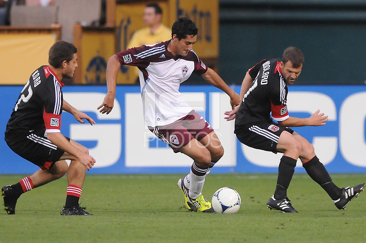 Colorado Rapids midfielder Tony Cascio (32) goes against D.C. United defender Daniel Woolard (21) right and defender Chris Korb (22) left. D.C. United defeated the Colorado Rapids 2-0 at RFK Stadium, Wednesday May 16, 2012.