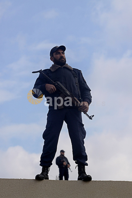 Palestinian policemen in Gaza Strip, take part in opening ceremony of a new police station, in Gaza City on Jan. 15,2011. Photo by Mohammed Asad