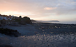 View at sunset over Bristol Channel towards Exmoor from Watchet, Somerset, England