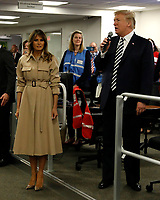 U.S. President Donald Trump speaks to employers next to First Lady Melania Trump and Vice President Mike Pence at the National Response Coordination Center inside the FEMA headquarters on June 6, 2018 in Washington, DC. <br /> <br /> CAP/MPI/RS<br /> &copy;RS/MPI/Capital Pictures