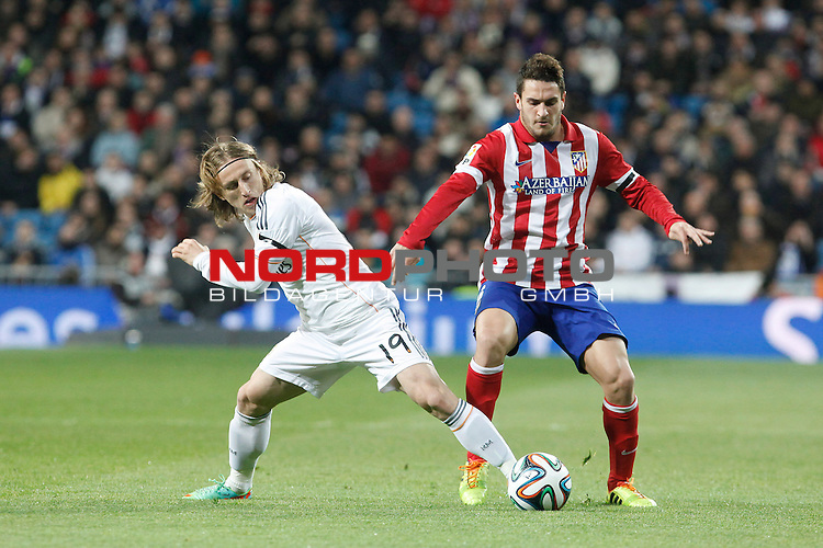 Real Madrid¬¥s Modric (l) and Atletico de Madrid¬¥s Koke (R) during King¬¥s Cup (Copa del Rey) semifinal match in Santiago Bernabeu stadium in Madrid, Spain. February 05, 2014. Foto © nph / Victor Blanco)