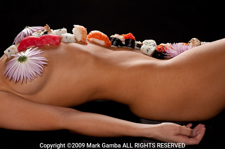 "Nyotaimori  ""female body presentation""), often referred to as ""body sushi,"" is the practice of eating sashimi or sushi from the body of a woman, typically naked. This sexual fetish is a subdivision of food play. As a result of being served on a human body, the temperature of the sushi or sashimi comes closer to body temperature."