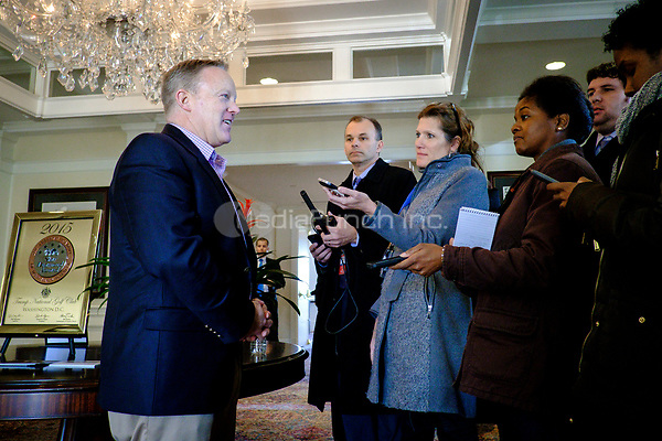 White House Press Secretary Sean Spicer briefs the press pool as United States President Donald Trump has a working lunch with staff and cabinet members and significant others at his golf course, Trump National Golf Club in Potomac Falls, Virginia, U.S., on Saturday, March 11, 2017.  <br /> Credit: Pete Marovich / Pool via CNP /MediaPunch