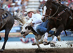 Joe Buffington competes in the steer wrestling event at the Reno Rodeo in Reno, Nev., on Thursday, June 27, 2013.<br /> Photo by Cathleen Allison