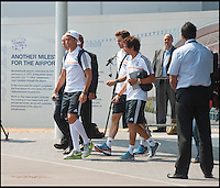 BNPS.co.uk (01202 558833)<br /> Pic: PhilYeomans/BNPS<br /> <br /> Ronaldo emerges from the terminal building.<br /> <br /> Footballing aristocrats Real Madrid flew into the unlikely enviroment of Bournemouth today for a much anticipated friendly against the seaside town's football team.<br /> <br /> Despite fears that their second team would turn up excited fans at the airport couldn't beleive their eyes when Ancelotti led out Ronaldo, Zidane, Kaka, Modric and many more stars from the terminal building.