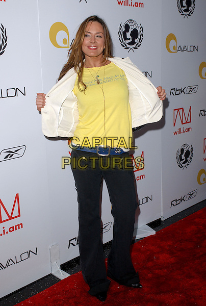 KRISTA ALLEN.Will.i.am Music Group and RBK's Tsunami Relief Benefit Concert held at Avalon in Hollywood, California .February 11th, 2005.full length logo slogan don't be mad at me when i'm mad at you taking jacket off gesture yellow.www.capitalpictures.com.sales@capitalpictures.com.Supplied By Capital PIctures