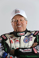 Feb. 22, 2013; Chandler, AZ, USA; NHRA funny car driver John Force poses for a portrait prior to qualifying for the Arizona Nationals at Firebird International Raceway. Mandatory Credit: Mark J. Rebilas-