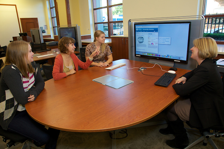 Emily Mackmiller, Nora Gabor, Celia DeBeer and Megan Bernal collaborate at one of the new media:scape tables in the Scholar's Lab. It is among the many new additions to the renovated Information Commons in the DePaul University John T. Richardson Library (Photo by Jeff Carrion)
