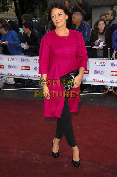 DAVINA McCALL.Arriving at the Pride of Britain Awards, The London Studios, London, SE1, October 9th 2007..full length red pink magenta coat dress black leggings clutch bag shoes buttons.CAP/CAS.©Bob Cass/Capital Pictures.