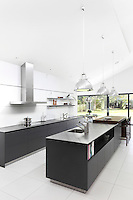 The spacious, black and white, Bulthaup 'Ward' kitchen with stainless steel work surfaces