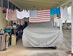 An American Flag on a clothesline in a residential area of Hawaii.