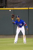 Round Rock Express outfielder Julio Borbon #20 makes a catch during the Pacific Coast League baseball game against the Oklahoma City RedHawks on June 15, 2012 at the Dell Diamond in Round Rock, Texas. The Express shutout the RedHawks 2-1. (Andrew Woolley/Four Seam Images).