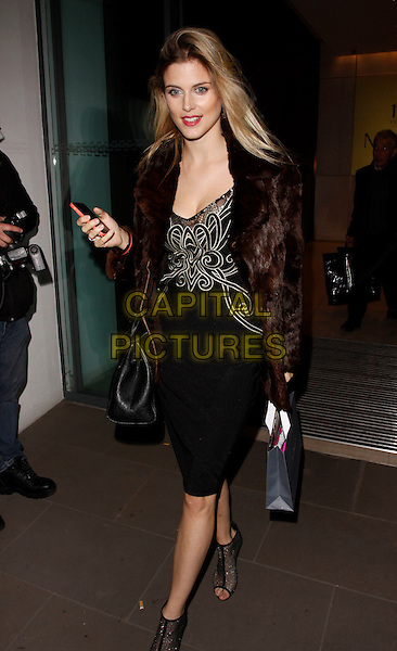 LONDON, ENGLAND - OCTOBER 21 :  Ashley James leaves the Myla - 15th anniversary party at The House of Myla on October 21, 2014 in London, England.<br /> CAP/AH<br /> &copy;Adam Houghton/Capital Pictures