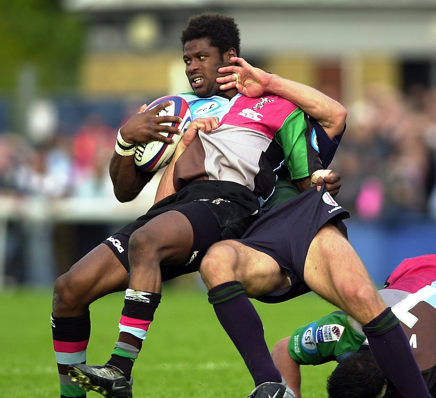 Photo:  Peter Spurrier..London Irish v NEC Harlequins. Zurich Premiership Rugby. 11/10/2003..Ugo Monye gets tackled...