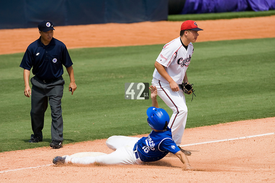 23 August 2007: Second base #16 Florian Peyrichou steals third base during the France 8-4 victory over Czech Republic in the Good Luck Beijing International baseball tournament (olympic test event) at the Wukesong Baseball Field in Beijing, China.
