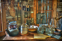 Table with household items used in the time period of exhibits at the McVay Log Cabin at McVay elementary School, in Westerville.