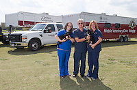 Mobile Veterinary Clinics in Front of CVM