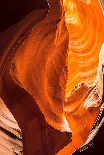The fluted walls shaped by millions of years of water and wind erosion highlight the experience at Upper Antelope Canyon on the Navajo Indian Reservation at Page Arizona