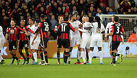 An argument that breaks out between Swansea and Bournemouth players during the Barclays Premier League match between Swansea City and Bournemouth at the Liberty Stadium, Swansea on November 21 2015