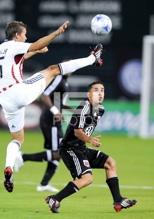 Chivas USA midfielder Jesse Marsch (15) kicks the ball against DC United defender Ivan Guerrero (12). Chivas USA defeated DC United 3-0, Saturday October 4, 2008 at RFK Stadium.