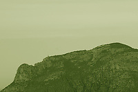 The profile of a mountain that appears as the face of a woman who is sleeping. The photo has been taken from the Giove's temple in Terracina. Monochrome. This is an enlargement of a part of the original image.