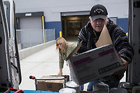 NWA Democrat-Gazette/CHARLIE KAIJO Warehouse Support, Juan Vieyra and Warehouse Manager, Vickie Nichols (from right) load supplies to a truck, Thursday, January 10, 2019 at the new Bentonville School District Warehouse in Bentonville. <br /><br />The new warehouse will house food commodities, district supplies, paper supplies, adventure club and child enrichment services supplies and snack packs for the students.