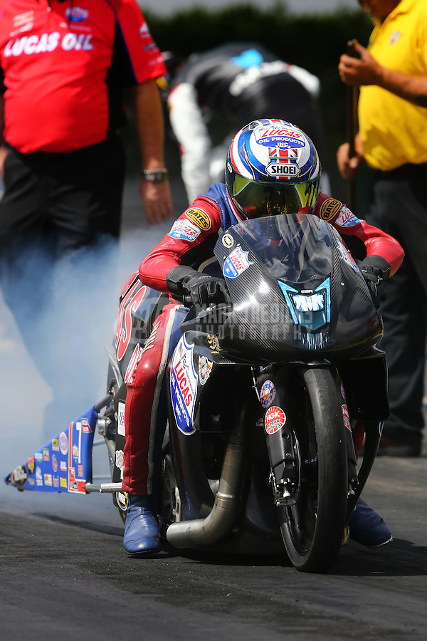 Mar 13, 2015; Gainesville, FL, USA; NHRA pro stock motorcycle rider Hector Arana Sr during qualifying for the Gatornationals at Auto Plus Raceway at Gainesville. Mandatory Credit: Mark J. Rebilas-