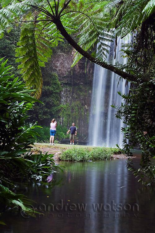 Couple at Millaa Millaa Falls on the Atherton Tablelands, near Cairns, Queensland, Australia