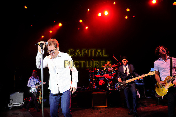 Huey Lewis<br /> Huey Lewis and The News performing in concert, Shepherd's Bush Empire, London, England. <br /> 1st October 2013<br /> on stage live gig performance music half length white shirt glasses  <br /> CAP/MAR<br /> &copy; Martin Harris/Capital Pictures