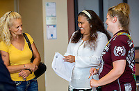 NWA Democrat-Gazette/JASON IVESTER <br /> Herminia Alcantara (center), adminstrative assistant, talks to Ashley Wilson (right) of Rogers on Wednesday, Aug. 19, 2015, and her mother Patsy Reynolds about the registration process for Wilson in Adult Education classes at Northwest Arkansas Community College in Bentonville. The school held a ribbon cutting for the new center that moved over the summer from the Center for Nonprofits in Rogers.
