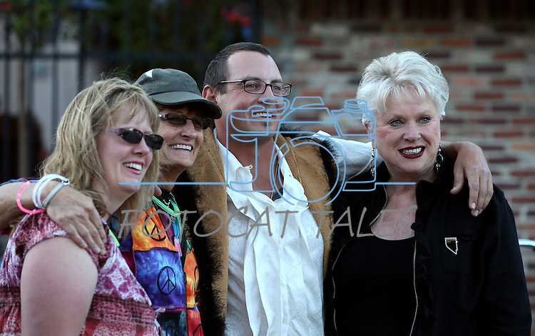 From left, Christy McOmber, Sue Jones, Kyle Horvath and Ronni Hannaman pose for photos at the first annual Blinky Man event in downtown Carson City, Nev., on Wednesday, June 19, 2013.<br /> Photo by Cathleen Allison