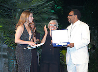 SPIKE LEE & LINA WERTMULLER .The Film Award Sesterzio Silver 2008 held at the Jardin de Russie,.Rome 24th June 2008..half length glasses white frames cross necklace cream suit pinstripe black robe dress clapping.CAP/CAV.©Luca Cavallari/Capital Pictures