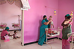 CHENNAI, INDIA, JULY 2012:.volunteer takes care of children newly arrived in the drop off center terres des homme, where mothers do not want to keep the kids can turn and make sure that all children will have the best care of the case.,july 2012.© Giulio Di Sturco.