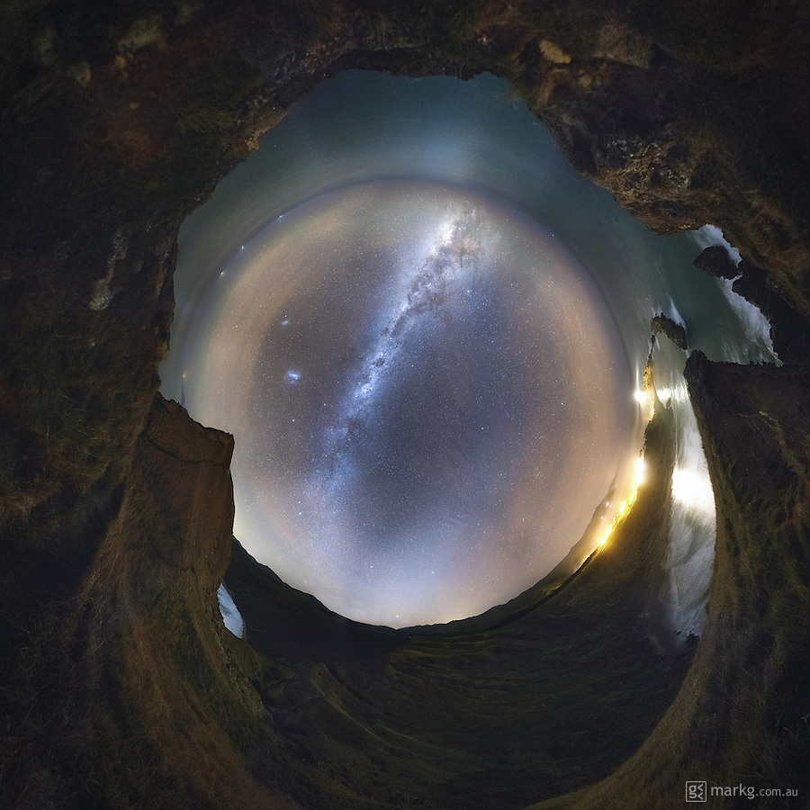 This is a 360 degree pano taken from atop of Castle Rock at Castlepoint in the Wairarapa, New Zealand. I made the climb under darkness, which made it somewhat more challenging than normal. Castle Rock stands at a height of 162m above sea level, and the Castlepoint lighthouse is perched 62m above sea level at the opposite end of the beach below. <br /> <br /> The galactic core of the Milky Way was rising to the east over the ocean, and the Small and Large Magellanic Clouds can be seen to the left of it. The Zodiacal Light is seen to the bottom right of the sky dome. The image consists of 32 images all shot at 24mm on a Gigapan Epic Pro.