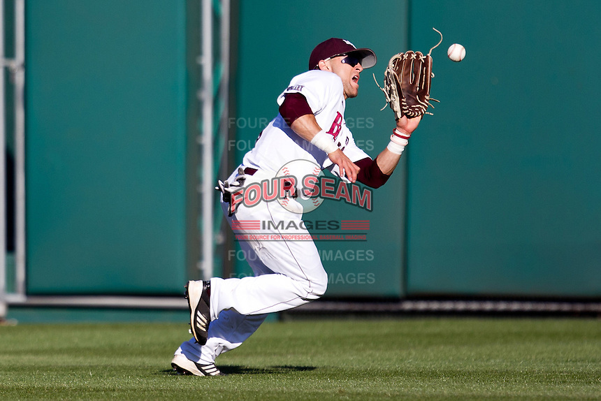 Spiker Helms (9) of the Missouri State Bears catches a ball in center field during a game against the Southern Illinois University- Edwardsville Cougars at Hammons Field on March 9, 2012 in Springfield, Missouri. (David Welker / Four Seam Images)