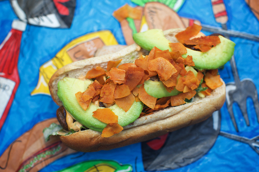 Brooklyn, NY - August 19, 2016:  The Cali Kush Dawg by Vendy Awards Best Vegan nominee Yeah Dawg, topped with kale caesar, avocado, smoked coconut and chipotle mayo.<br /> <br /> CREDIT: Clay Williams for Gothamist.<br /> <br /> &copy; Clay Williams / claywilliamsphoto.com