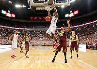 Ohio State Buckeyes forward Sam Thompson (12) throws down a dunk over the head of Minnesota Golden Gophers forward Maurice Walker (15) during the second half of the NCAA men's basketball game between the Ohio State Buckeyes and the Minnesota Golden Gophers at Value City Arena in Columbus, Ohio, on Saturday, Feb. 22, 2014. The Buckeyes overcame a 10-point deficit at the half to defeat the Minnesota Golden Gophers 64-46. (Columbus Dispatch/Sam Greene)