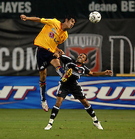 Monarcas Morelia Gonzalo Choy (11)  goes up for the header against DC United midfielder Fred (7). Monarcas Morelia tied DC United 1-1 in  the SuperLiga opening match of the group B, at RFK Stadium Washington DC, Wednesday July 26, 2007.