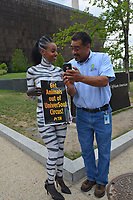 Washington  DC, June 22, 2017, USA: A member of PETA (People for the Ethical Treatment of Animals) is dressed as a Zebra in body paint to protest a circus coming to the Washington DC area. A employee of the African American museum shows the PETA protestor a selfie he took of the two of them. Patsy Lynch/MediaPunch