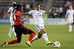 15 October 2014: Carli Lloyd (USA) (10) and Rhea Belgrave (TRI) (4). The United States Women's National Team played the Trinidad and Tobago Women's National Team at Sporting Park in Kansas City, Kansas in a 2014 CONCACAF Women's Championship Group A game, which serves as a qualifying tournament for the 2015 FIFA Women's World Cup in Canada. The United States won the game 1-0.